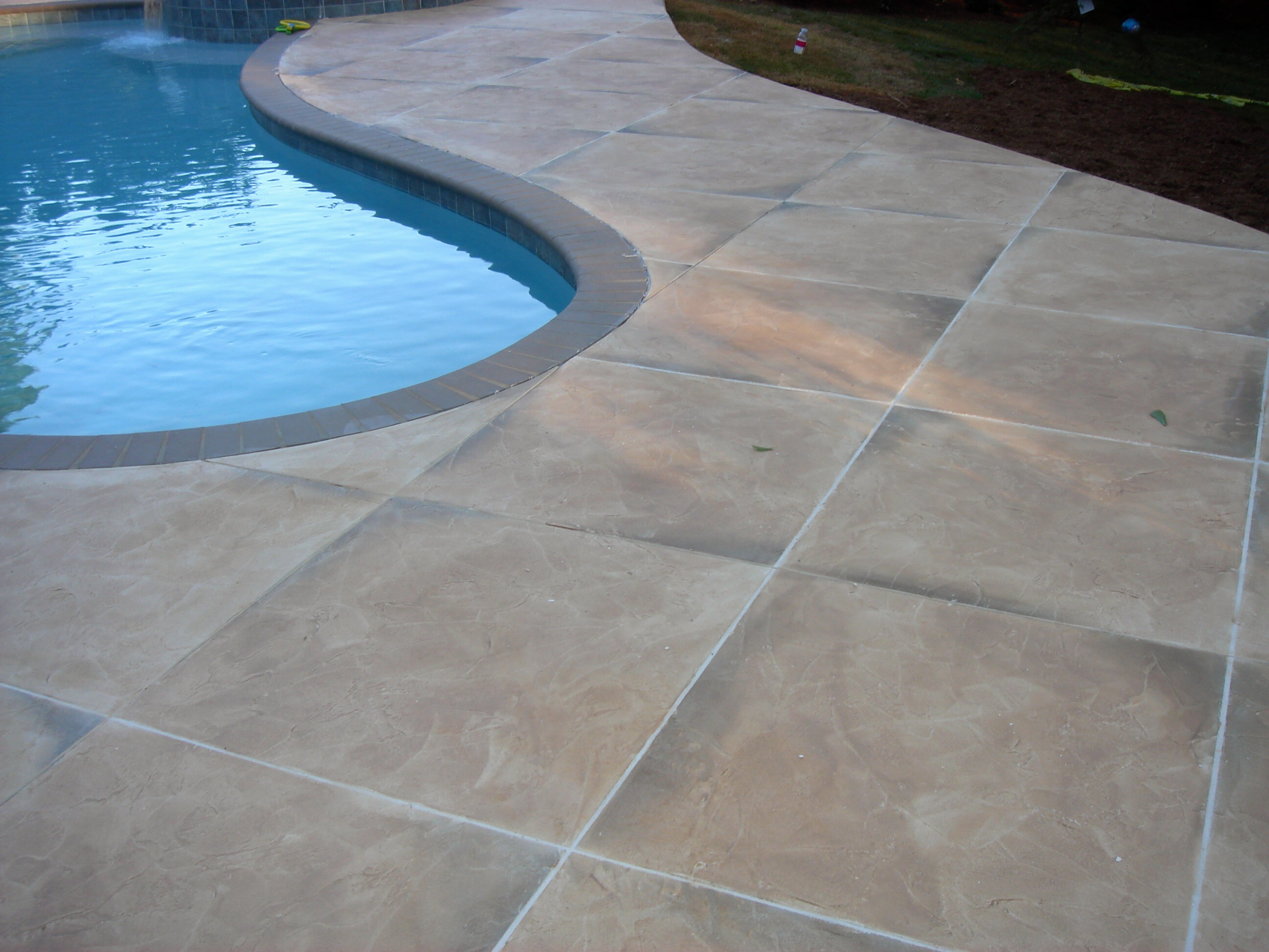 Repair your pool decking with concrete lifting lift for Concrete pool