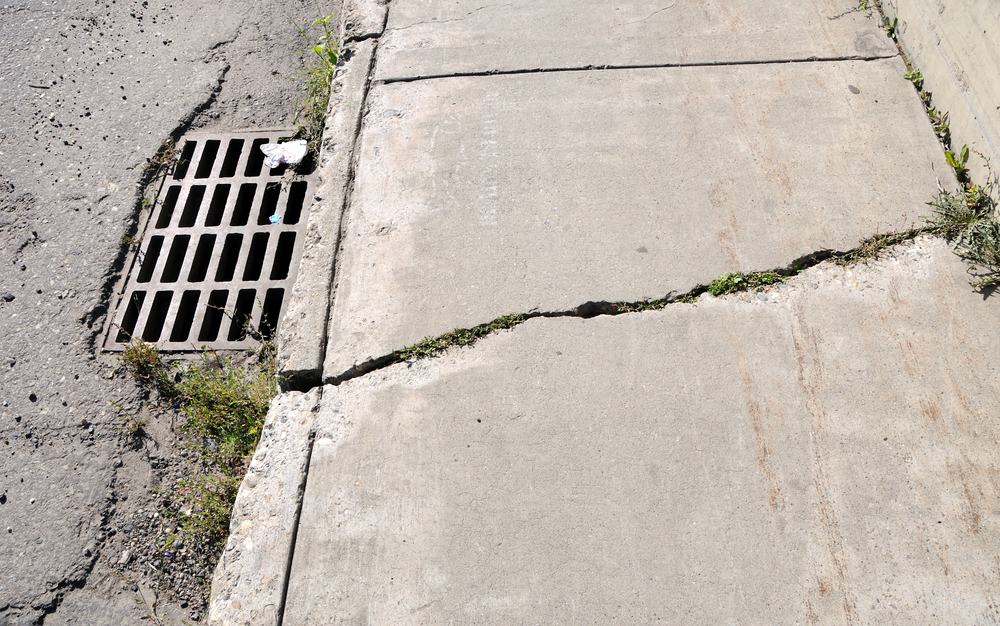 broken sidewalk concrete repair